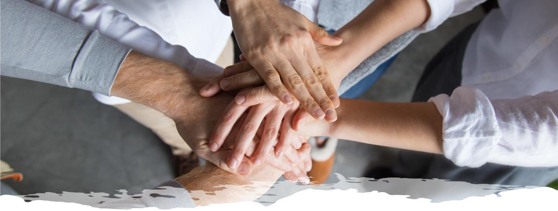 manos unidas de equipo